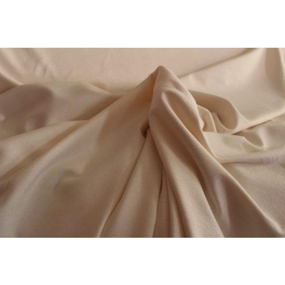 Világos bézs színű rugalmas pamutanyag